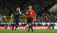 Referee Ivan Bebek blows his whistle as Stephan El Shaarawy of Monaco holds his head during the UEFA Europa League group match between Tottenham Hotspur and Monaco at White Hart Lane, London, England on 10 December 2015. Photo by Andy Rowland.