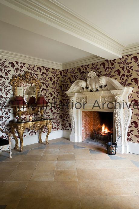 Large stone fireplace in entrance hall