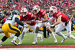 Wisconsin Badgers teammates Seth Currens (10), Adam Krumholz (24) and Joe Ferguson (8) line up on special teams during an NCAA College Big Ten Conference football game against the Iowa Hawkeyes Saturday, November 11, 2017, in Madison, Wis. The Badgers won 38-14. (Photo by David Stluka)