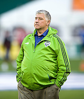Seattle Sounders head coach Sigi Schmid watches his team before the game at RFK Stadium in Washington DC.   D.C. United tied  the Seattle Sounders, 0-0.