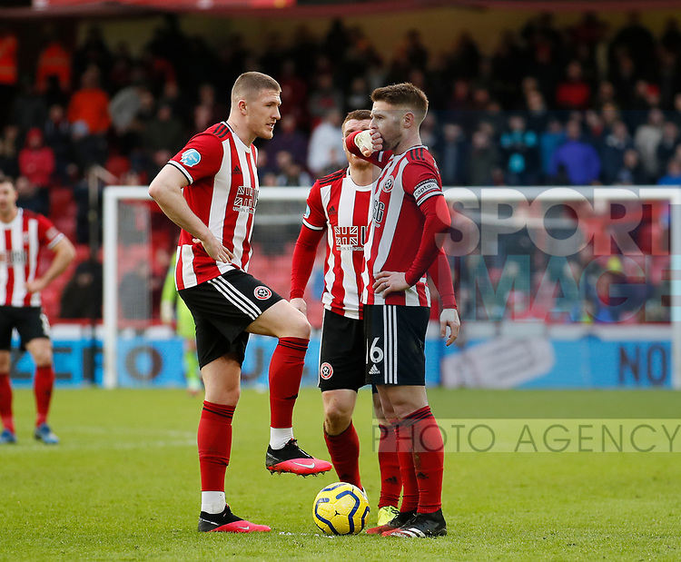 John Lundstram of Sheffield Utd  discusses a free kick with Oliver Norwood of Sheffield Utd during the Premier League match at Bramall Lane, Sheffield. Picture date: 9th February 2020. Picture credit should read: Simon Bellis/Sportimage