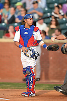 Chattanooga Lookouts catcher J.C. Boscan (15) gets a new ball during a game against the Birmingham Barons on April 24, 2014 at AT&T Field in Chattanooga, Tennessee.  Chattanooga defeated Birmingham 5-4.  (Mike Janes/Four Seam Images)