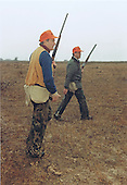 United States President George H.W. Bush, left, and Will Farish hunt quail on the Lazy F Ranch near Beeville, Texas on December 28, 1989.<br /> Mandatory Credit: David Valdez / White House via CNP