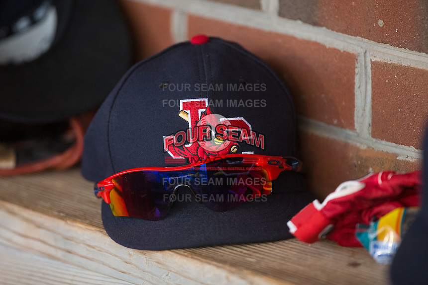 A Johnson City Cardinals cap sits on the bench in the home dugout during the game against the Bristol Pirates at Howard Johnson Field at Cardinal Park on July 6, 2015 in Johnson City, Tennessee.  The Cardinals defeated the Pirates 8-2 in game two of a double-header. (Brian Westerholt/Four Seam Images)