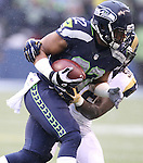 Seattle Seahawks running back Fred Jackson (22) carries the ball against the St. Louis Rams at CenturyLink Field in Seattle, Washington on December 27, 2015.  The Rams beat the Seahawks 23-17.      ©2015. Jim Bryant Photo. All Rights Reserved