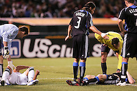 Joe Cannon (left) checks on Bryan Jordan (left, ground) while Nick Garcia (3) the referee and Simon Elliot (right) check on Chris Leitch (4) after their collision. San Jose Earthquakes tied Los Angeles Galaxy 1-1 at the McAfee Colisum in Oakland, California on April 18, 2009.