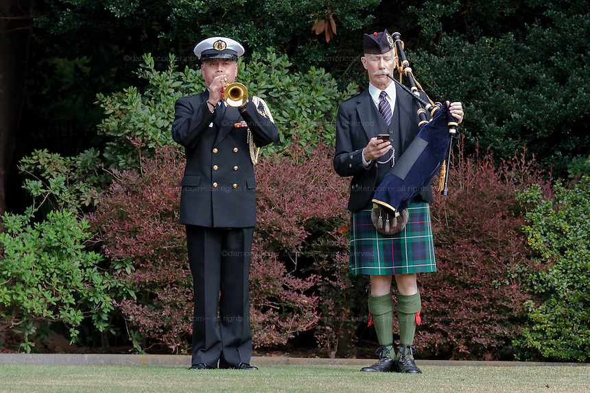 Bugler, Petty officer First Class, Haruo Muta and Bagpiper, Frank Hunter during the Remembrance Day ceremonies at the Commonwealth War Cemetery in Hodogaya, Yokohama, Japan. Wednesday November 11th 2015