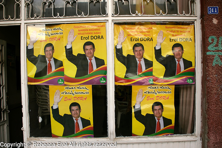 Election posters in Turkish, Kurdish and Assyrian for independent candidate Erol Dora in Savur, Southeastern Turkey