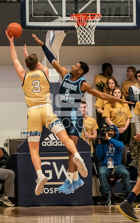 WASHINGTON, DC - FEBRUARY 8: Antwan Walker #5 of Rhode Island defends a shot attempt by Chase Paar #3 of George Washington during a game between Rhode Island and George Washington at Charles E Smith Center on February 8, 2020 in Washington, DC.