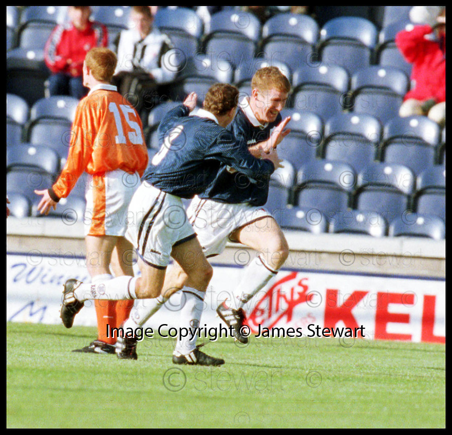 11th October 98      .Copyright Pic : James Stewart   .RAITH ROVERS V ST.MIRREN.KEITH WRIGHT (9) IS CONGRATULATES BY KEVIN BYRES (8) AFTER HE SCORED RAITHS GOAL....Payments to :-.James Stewart Photo Agency, Stewart House, Stewart Road, Falkirk. FK2 7AS      Vat Reg No. 607 6932 25.Office : 01324 630007        Mobile : 0421 416997.If you require further information then contact Jim Stewart on any of the numbers above.........