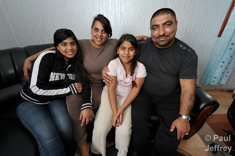 A Roma family in the Zemun Polje neighborhood of Belgrade, Serbia. Many families in this neighborhood are refugees from Kosovo. Lacking legal status in Serbia, many have difficulty obtaining formal employment and accessing government services.