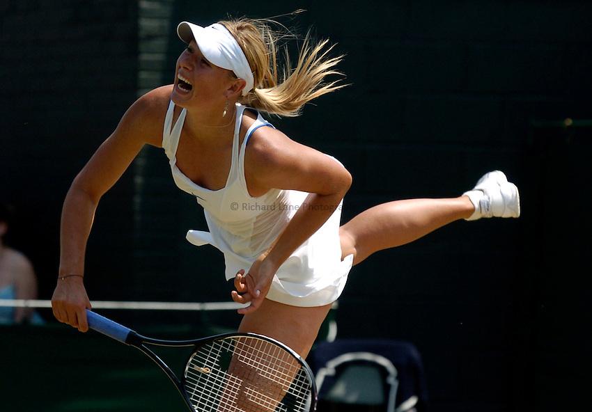 Photo: Richard Lane..Wimbledon Championships. 03/07/2006. .Maria Sharapova of Russia serves serves.