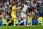 Villarreal's Victor Ruiz and Real Madrid's Karim Benzema during the match of La Liga between Real Madrid  and Villarreal Club de Futbol at Santiago Bernabeu Estadium in Madrid. September 21, 2016. (ALTERPHOTOS/Rodrigo Jimenez)