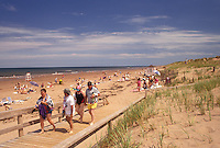 beach, Prince Edward Island National Park, P.E.I., Canada, Prince Edward Island, Gulf of St. Lawrence, People enjoying the sun and surf on Cavendish Beach at Prince Edward Island National Park on Prince Edward Island.