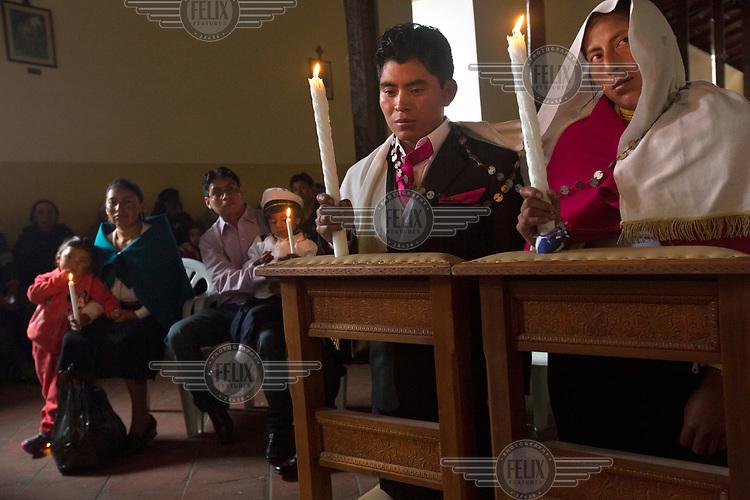 The wedding ceremony of Luis Lema, 24, and Marimam Cando, 25.