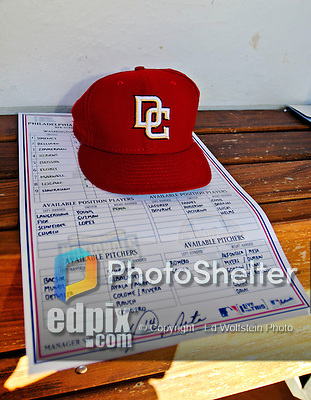 23 September 2007: A Washington Nationals cap lies on the very last RFK roster card, signed by Manager Manny Acta, in the Nationals' dugout prior to a game against the Philadelphia Phillies at Robert F. Kennedy Memorial Stadium in Washington, DC. The Nationals defeated the visiting Phillies 5-3 to close out the 2007 home season and the final game in baseball history at RFK Stadium. The Nationals will open up the 2008 season at Nationals Park, their new facility currently under construction.. .Mandatory Photo Credit: Ed Wolfstein Photo