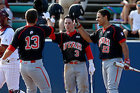 Kody Davis #3 and Dallas Carroll #23 of the Utah Utes greet teammate T. J. Bennett after his home run against the Loyola Marymount Lions at Page Stadium on February 15, 2013 in Los Angeles, California. Utah defeated Loyola 6-3. (Larry Goren/Four Seam Images)