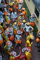 Pulikali performers standing in a narrow alley, Trichur, Kerala, India..Pulikali or Kaduvvakali is a two hundred year old folk dance form, practised mostly in Thrissur and Palghat districts of Kerala. It liberally makes use of forms and symbols of nature that finds expression in its bright, bold body painting and high-energy dance movements. The philosophy of Pulikali is that human and nature are integral parts of each other. So by fusing man and beast in its artistic language, it flamboyantly celebrates the connection. Arindam Mukherjee