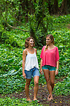 Two women in the forest, laughing in nature, Maui, Hawaii, USA