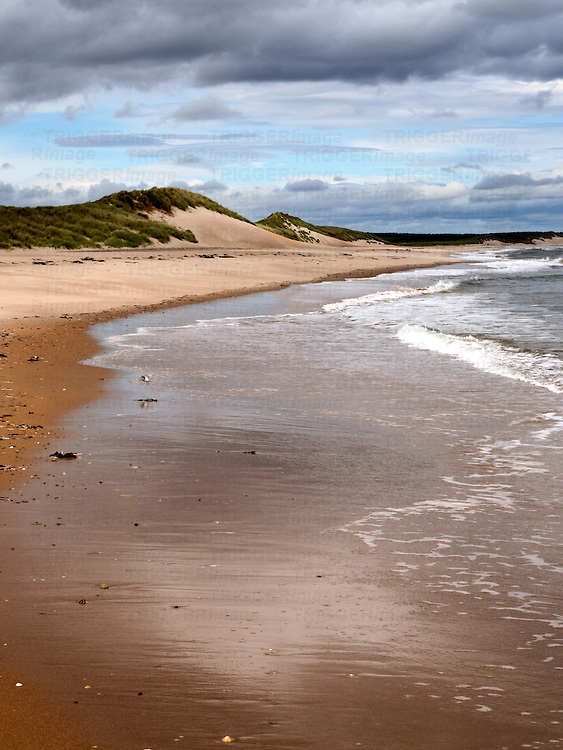 Sand Dunes and Incoming Tide at Druridge Bay near Amble by the Sea on the Northumberland Coast England