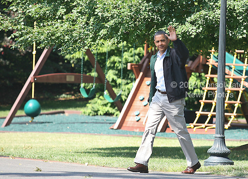 United States President Barack Obama waves to the media as he walks to an awaiting Marine One on the South Lawn of the White House, Washington, DC, Saturday, July 9, 2011. The President was en route to Camp David where the first family is to spend the night..Credit: Martin Simon / Pool via CNP