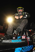 Nov 14, 2010; Pomona, CA, USA; NHRA top alcohol dragster driver Michael Manners climbs from his car after winning the Auto Club Finals at Auto Club Raceway at Pomona. Mandatory Credit: Mark J. Rebilas-