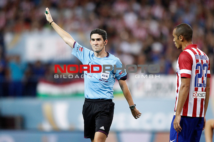 Atletico de Madrid's Joao Miranda (r) have words with the referee Alberto Undiano Mallenco during Supercup of Spain 1st match.August 21,2013. Foto © nph / Acero)