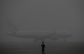 United States President Donald J. Trump and First Lady Melania Trump onboard Air Force one depart from Joint Base Andrews, Maryland on a foggy morning on September 11, 2018. The President and First Lady attend the Flight 93 September 11 Memorial Service in Shanksville, PA. <br /> Credit: Olivier Douliery / Pool via CNP