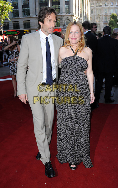 "DAVID DUCHOVNY & GILLIAN ANDERSON.The UK Premiere of ""The X Files - I Want To Believe"", Empire Leicester Square, London, England..July 30th, 2008 .full length black print halterneck maxi dress pregnant tie beige grey suit jacket .CAP/BEL.©Tom Belcher/Capital Pictures."