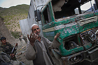 The driver of a NATO supply truck destroyed by a roadside bomb pleads with US soldiers to recover his vehicle so it isn't destroyed by the Taliban during the night. The HHT Unit of the 3rd Brigade Combat Team, 1st Infantry Division responded to an IED (improvised explosive device) attack on a coalition supply convoy. The bomb destroyed a supply truck carrying Humvee spare parts.