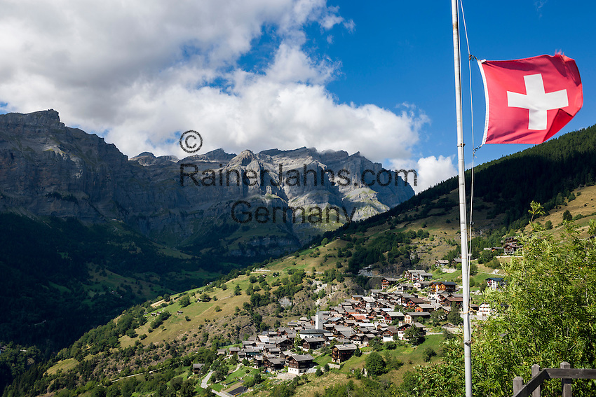 Switzerland, Canton Valais, Albinen: village at entrance to Dala Valley famous for its Valais mountain farmer houses and barns, Bernese Alps at background | Schweiz, Kanton Wallis, Albinen: Dorf am Eingang zum Dalatal mit vielen Walliser Bergbauernhaeusern und Bergbauernscheunen, im Hintergrund Berge der Berner Alpen