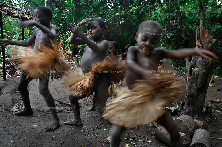 Salate is 20km west of Epulu... Boys are going thru the end of the circumcision ceremony called Kumbi.  The boys always wear the ceremonial skirts for their circumcision ceremonies and the girls as well.  When they take off the skirts at the end of the ceremony, they will be hung in the trees.
