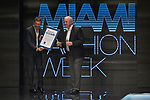 MIAMI, FL - MAY 30: Antonio Banderas receives a proclamation from Miami Dade County Mayor Carlos A. Gimenez before the RR by Rene Fashion Show during Miami Fashion Week at Ice Palace Film Studios on May 30, 2019 in Miami, Florida. . ( Photo by Johnny Louis / jlnphotography.com )