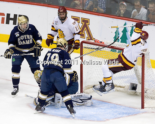 Sean Lorenz (Notre Dame - 24), Travis Oleksuk (Duluth - 11), Mike Johnson (Notre Dame - 32), Ben Ryan (Notre Dame - 19), Kyle Schmidt (Duluth - 7) - The University of Minnesota-Duluth defeated the University of Notre Dame Fighting Irish 4-3 in their 2011 Frozen Four Semi-Final on Thursday, April 7, 2011, at the Xcel Energy Center in St. Paul, Minnesota.