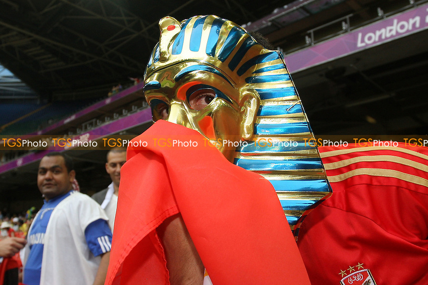 An Egyptian fan kisses his national flag inside the stadium before kick-off - Brazil vs Egypt - Mens Olympic Football Tournament London 2012 Group E at the Millenium Stadium, Cardiff, Wales - 26/07/12 - MANDATORY CREDIT: Gavin Ellis/SHEKICKS/TGSPHOTO - Self billing applies where appropriate - 0845 094 6026 - contact@tgsphoto.co.uk - NO UNPAID USE.