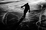 Stockholm 2014-03-21 Ishockey Kvalserien AIK - R&ouml;gle BK :  <br /> Siluett av ishockeyspelare p&aring; isen i ett nedsl&auml;ckt Hovet<br /> (Foto: Kenta J&ouml;nsson) Nyckelord:  portr&auml;tt portrait svartvitt svartvit intro