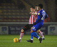 Lincoln City's Lee Frecklington vies for possession with Morecambe's Jordan Cranston<br /> <br /> Photographer Chris Vaughan/CameraSport<br /> <br /> The EFL Sky Bet League Two - Saturday 15th December 2018 - Lincoln City v Morecambe - Sincil Bank - Lincoln<br /> <br /> World Copyright © 2018 CameraSport. All rights reserved. 43 Linden Ave. Countesthorpe. Leicester. England. LE8 5PG - Tel: +44 (0) 116 277 4147 - admin@camerasport.com - www.camerasport.com
