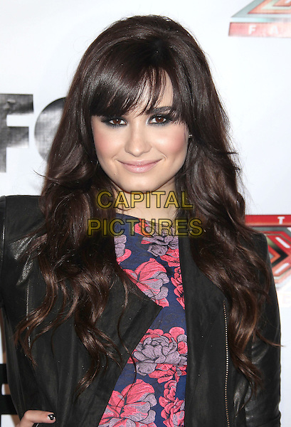 "Demi Lovato.""The X-Factor"" Viewing Party Sponsored By Sony X Headphones held at Mixology at The Grove, Los Angeles, California, USA, December 7th 2012..portrait headshot black leather dress red floral print navy blue fringe make-up blusher eyeliner beauty .CAP/ADM/RE.©Russ Elliot/AdMedia/Capital Pictures."