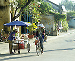Hoi An Early Morning - Early morning street scene with vendor and cyclist in Bach Dang St, Hoi An, Viet Nam