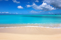 A serene morning looking out of the crystal blue waters of the Leeward Islands, West Indies.