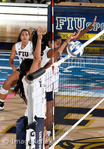 Florida International University women's volleyball outside hitter/setter Tia Clay (18) plays against  the University of Central Florida which won the match 3-0 on September 17, 2015 at Miami, Florida.