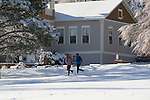 Men running in the snow, Boulder, Colorado, USA .  John leads private photo tours in Boulder and throughout Colorado. Year-round.