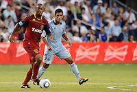 Collen Warner (red) Real Salt Lake watched by Jeferson Sporting KC... Sporting Kansas City defeated Real Salt Lake 2-0 at LIVESTRONG Sporting Park, Kansas City, Kansas.