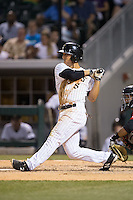 Tyler Saladino (8) of the Charlotte Knights follows through on his swing against the Indianapolis Indians at BB&T BallPark on June 20, 2015 in Charlotte, North Carolina.  The Knights defeated the Indians 6-5 in 12 innings.  (Brian Westerholt/Four Seam Images)