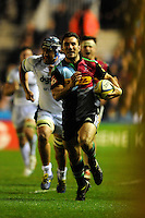 George Lowe of Harlequins makes a break for the line