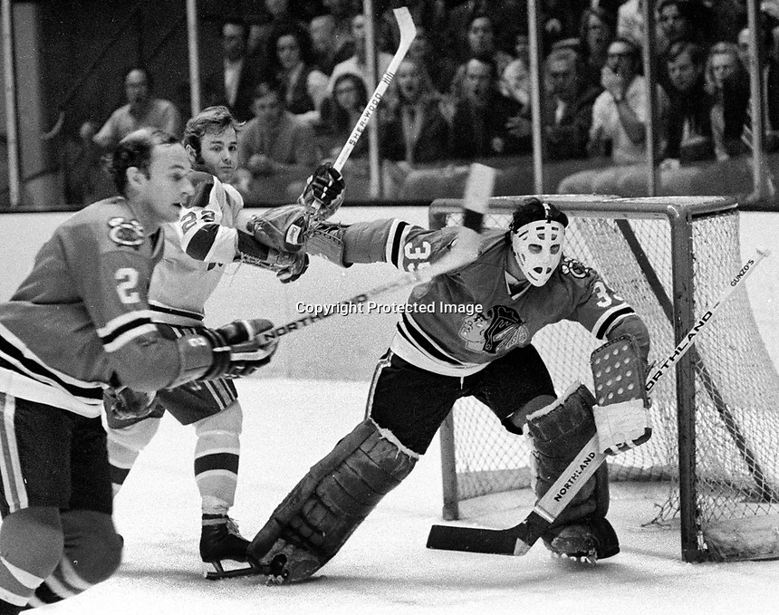Chicago Black Hawks goalie Tony Esposito, and #2 Bill White, Seals Joey Johnston..(1971 photo/Ron Riesterer)