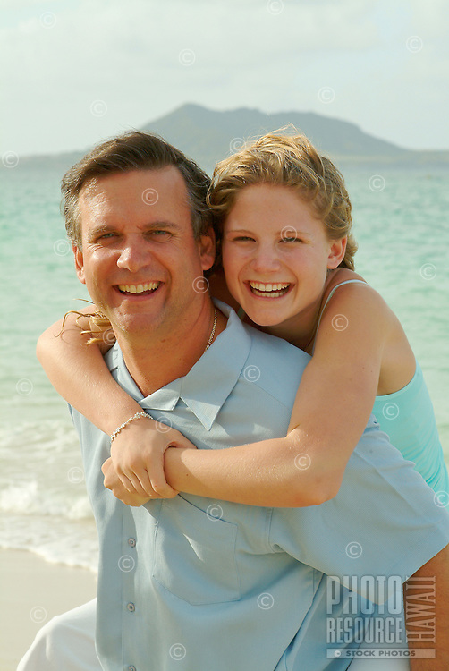 Father and daughter on the beach during a family vacation