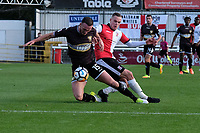 Tom Aldred of Bury and Joe Ward of Woking during Woking vs Bury, Emirates FA Cup Football at The Laithwaite Community Stadium on 5th November 2017