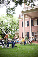 Locals and visitors mix at the weekly bluegrass on the lawn event at the stately Carolina Inn.