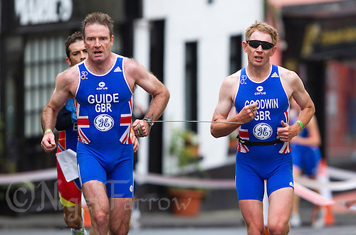 03 JUL 2010 - ATHLONE, IRL - Chris Goodwin (right) with his guide on his way to winning a silver medal in the Mens Paratri 6 category at the European Paratriathlon Championships .(PHOTO (C) NIGEL FARROW)